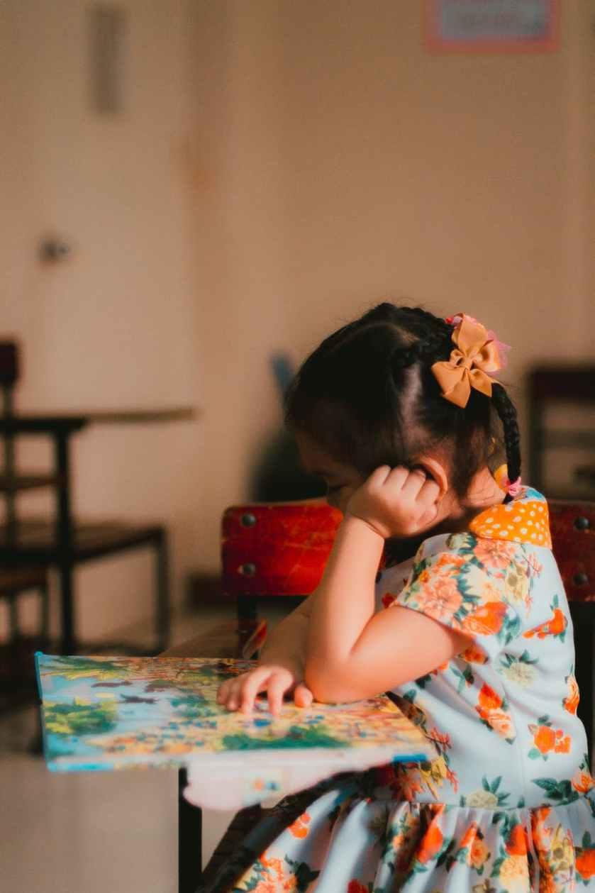 girl on armchair at school