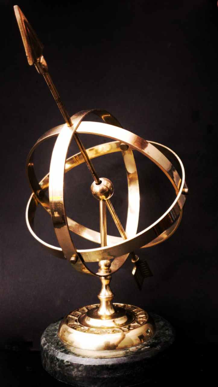 brass colored and black table decor